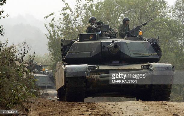 Pocheon, REPUBLIC OF KOREA: US M1 Abraham tanks during a mechanized military exercise at the Yeongpyeong River, in Pocheon near the DMZ, 18 October...