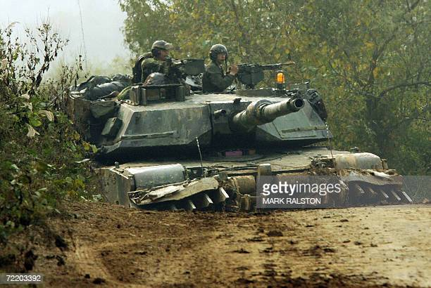 Pocheon, REPUBLIC OF KOREA: US M1 Abraham tanks equiped with mine clearing devices during a mechanized military exercise at the Yeongpyeong River, in...