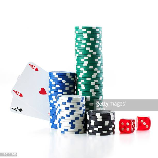 Pocket aces poker hand hiding behind a stack of poker chips