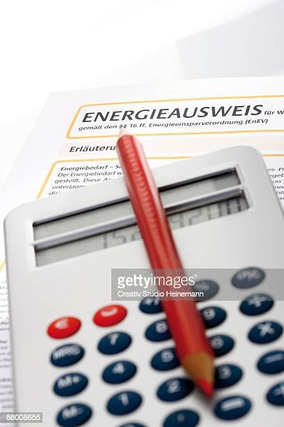Pocket calculator and energy pass, close-up