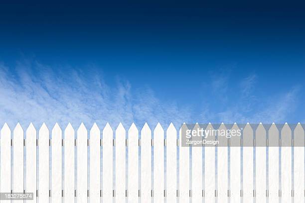 pocket fence painted white with blue sky - hek stockfoto's en -beelden