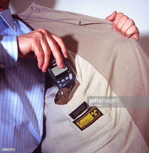 Pocket for cellular phone lined w copper polyamide polyurethane shield to protect wearer from harmful emissions in $595 coat selling at Barney's...