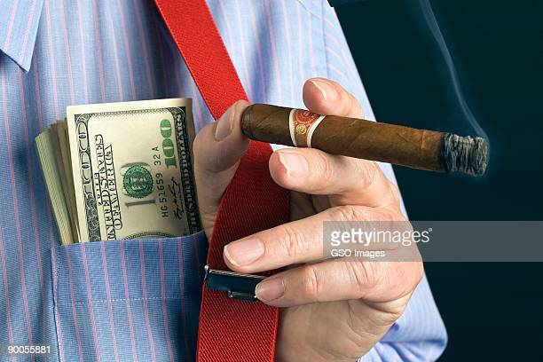 pocket full of dollars - excess stock photos and pictures
