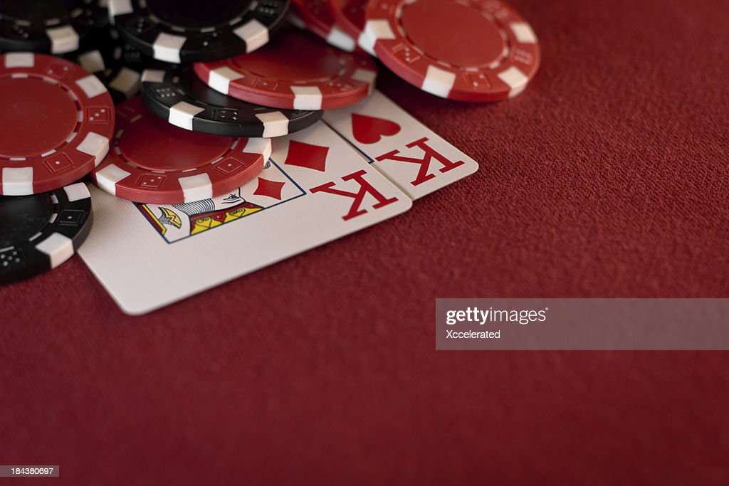 Pocket Kings with Poker Chips on Red Felt : Stock Photo