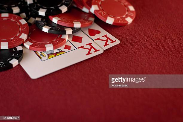 Pocket Kings with Poker Chips on Red Felt