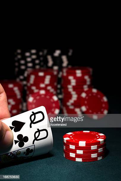 Pocket Queens with red & black poker chips