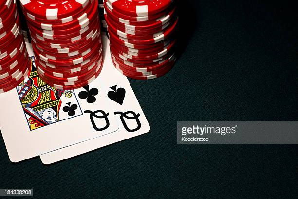 pocket queens with red poker chips - texas hold 'em stock pictures, royalty-free photos & images