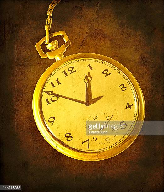pocket watch and chain with textured background - pocket chain stock pictures, royalty-free photos & images