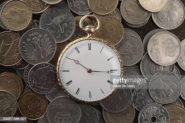Pocket watch and collection of coins