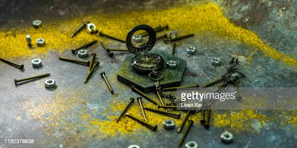 pocket watch and nail - liyao xie photos et images de collection