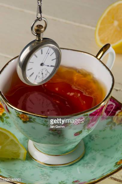 pocket watch and teacup - ian gwinn bildbanksfoton och bilder