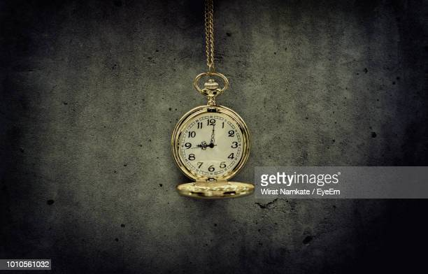 Pocket Watch Hanging Against Wall
