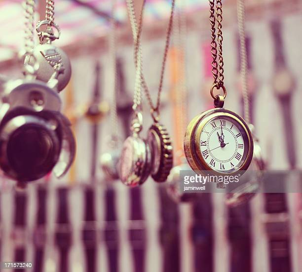 pocket watches hanging on chain