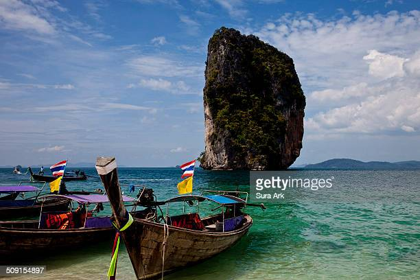 Poda island is no more than a kilometre in diameter, covered in palm trees and almost entirely encircled by a soft white sand beach.