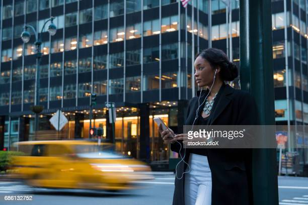 podcast on the go - midtown manhattan stock pictures, royalty-free photos & images