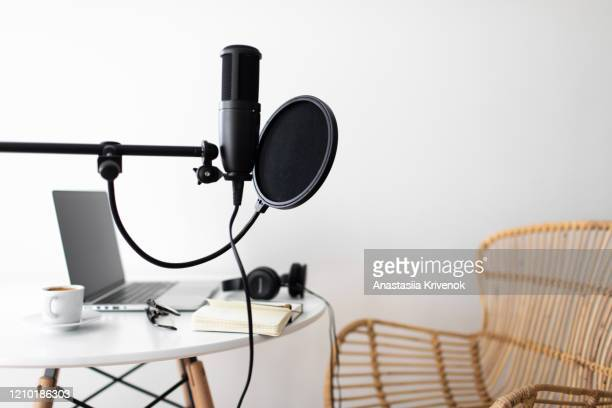 podcast streaming at home. audio studio with laptop, microphone with pop filter and headphones on white table. - podcast stock-fotos und bilder