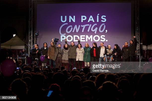 Podemos leader Pablo Iglesias and other party member acknowledge their supporters after learning the final general elections results at Hotel...