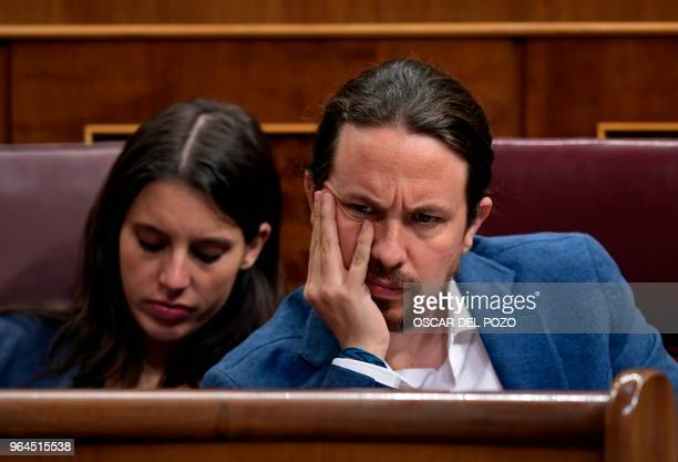 TOPSHOT Podemos party MPs Pablo Iglesias and Irene Montero attend a debate on a noconfidence motion tabled by Spanish Socialist party at the Lower...