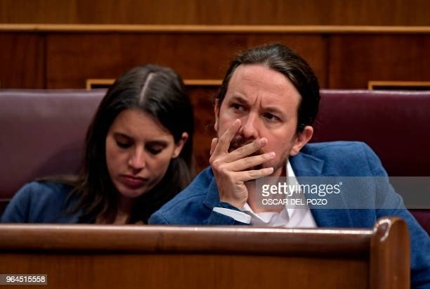 Podemos party MPs Pablo Iglesias and Irene Montero attend a debate on a noconfidence motion tabled by Spanish Socialist party at the Lower House of...