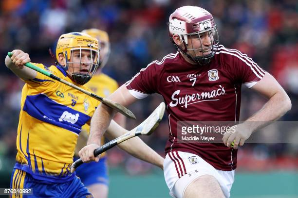 Podge Collins of Clare defends Conor Cooney of Galway during the 2017 AIG Fenway Hurling Classic and Irish Festival at Fenway Park on November 19...