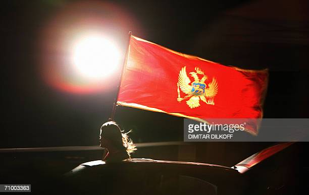 A supporter of Montenegrin independence waves Montenegrin flag and celebrates in Podgorica 21 May 2006 after an independent monitoring group said...