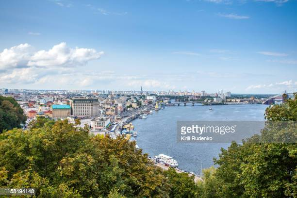 podil district of kyiv and dnipro river on a bright summer day - kiew stock-fotos und bilder