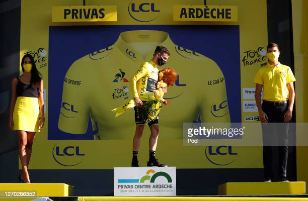 Podium / Adam Yates of The United Kingdom and Team Mitchelton Scott Yellow Leader Jersey / Celebration / Lion Mascot / during the 107th Tour de...
