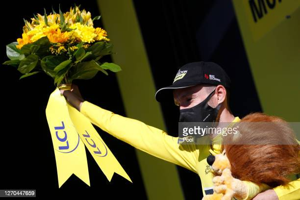 Podium / Adam Yates of The United Kingdom and Team Mitchelton Scott Yellow Leader Jersey / Celebration / Lion Mascot / Flowers / during the 107th...