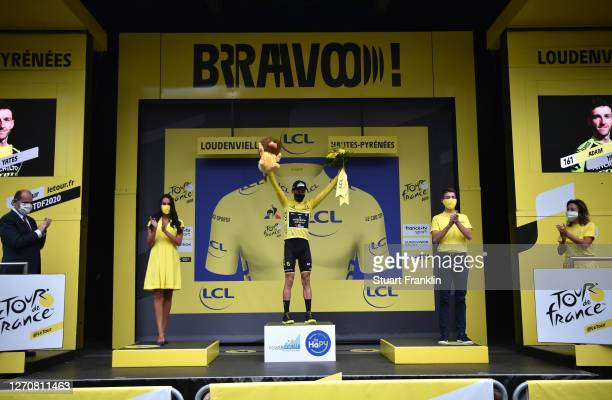 Podium / Adam Yates of The United Kingdom and Team Mitchelton Scott Yellow Leader Jersey / Celebration / Lion Mascot / Trophy / during the 107th Tour...