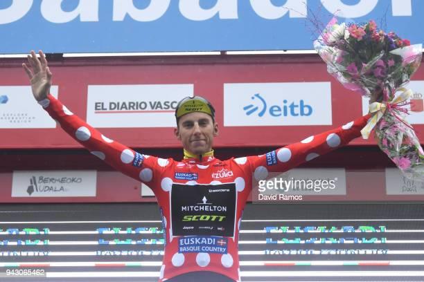 Podium / Carlos Verona Quintanilla of Spain and Team MitcheltonScott Polka Dot Mountain Jersey / Celebration / Flowers / Children / during the 58th...