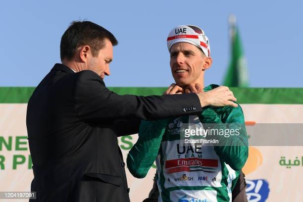 Podium / David Lappartient of France President of the Union Cycliste Internationale UCI / Rui Costa of Portugal and UAE Team Emirates Green Leader...