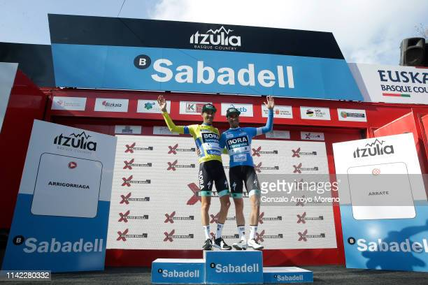 Podium / Emanuel Buchmann of Germany and Team Bora Hansgrohe Yellow Leader Jersey / Maximilian Schachmann of Germany and Team Bora Hansgrohe Blue...