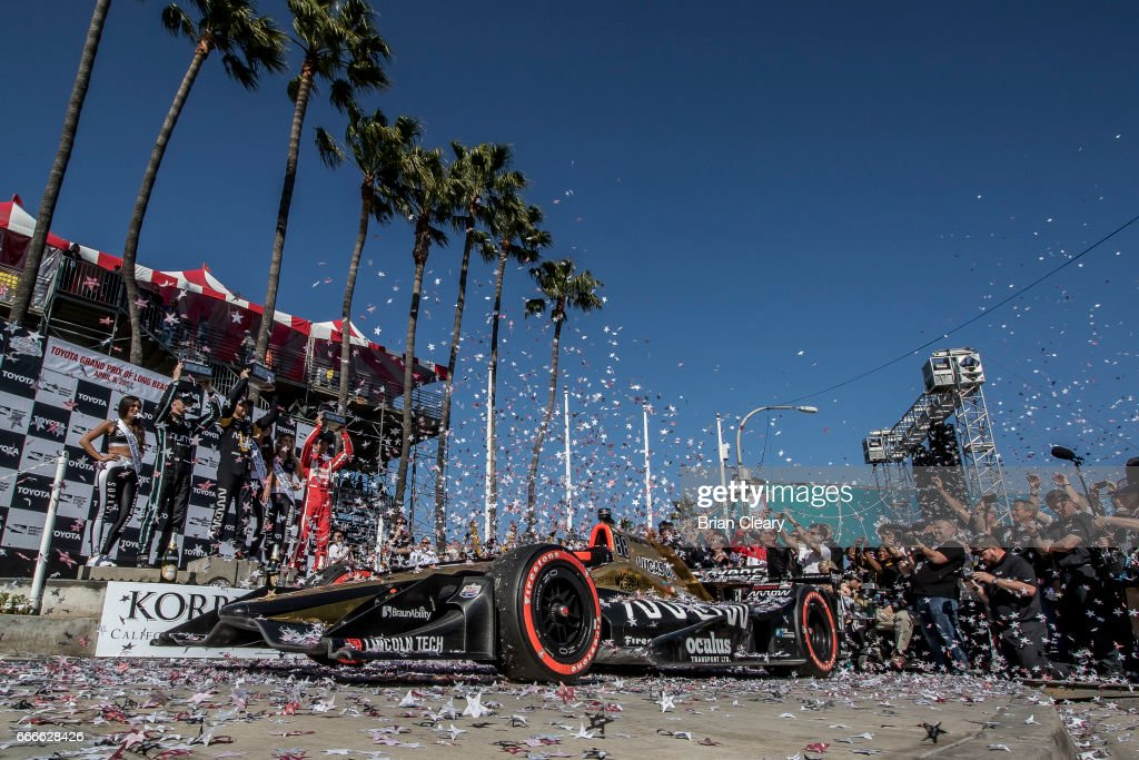 Podium finishers L to R Josef Newgarden James Hinchcliffe of Canada and Sebastien Bourdais of France celebrate in victory lane after the Grand Prix at Long Beach IndyCar race on April 9, 2017 in Long Beach California.