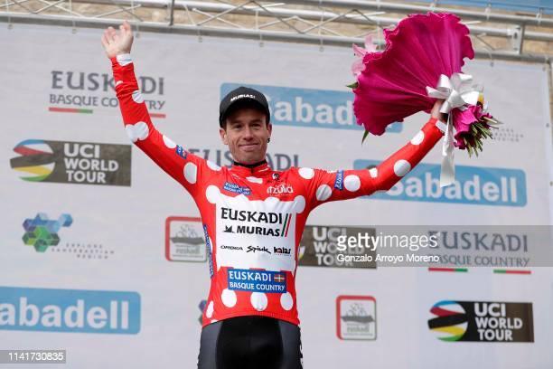 Podium / Garikoitz Bravo of Spain and Team Euskadi Basque Country - Murias Polka Dot Mountain Jersey / Celebration / Flowers / during the 59th...
