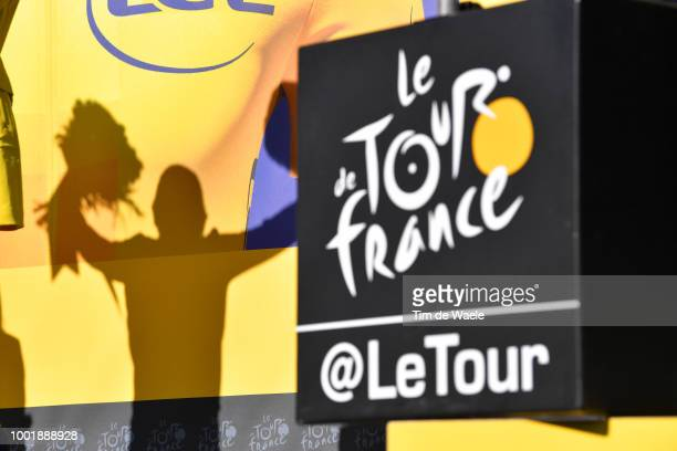 Podium / Geraint Thomas of Great Britain and Team Sky Yellow Leader Jersey / Celebration / Flowers / Shadow / Silhouet / TDF logo / during the 105th...