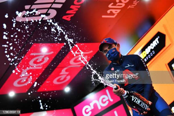 Podium / Jhonnatan Narvaez Prado of Ecuador and Team INEOS Grenadiers / Celebration / Champagne / Mask / Covid safety measures / during the 103rd...