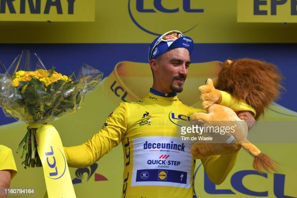 Podium / Julian Alaphilippe of France and Team Deceuninck - Quick-Step Yellow Leader Jersey / Celebration / Lion Mascot / during the 106th Tour de...