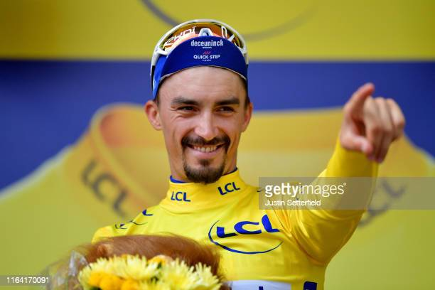 Podium / Julian Alaphilippe of France and Team Deceuninck - Quick-Step Yellow Leader Jersey / Celebration / during the 106th Tour de France 2019,...