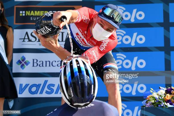 Podium / Mathieu Van Der Poel of The Netherlands and Team Alpecin-Fenix / Celebration / Champagne / during the 55th Tirreno-Adriatico 2020, Stage 7 a...