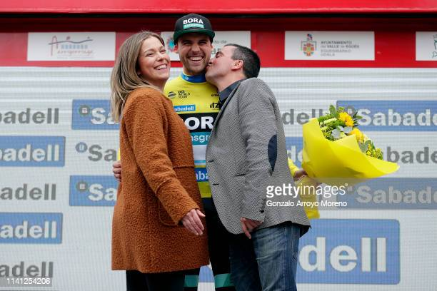Podium / Maximilian Schachmann of Germany and Team Bora - Hansgrohe Yellow Leader Jersey / Celebration / Hostess / Kiss / Flowers / during the 59th...
