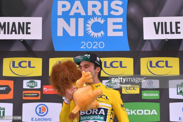 Podium / Maximilian Schachmann of Germany and Team Bora - Hansgrohe Yellow Leader Jersey / Celebration / Trophy / Lion Mascot / during the 78th Paris...