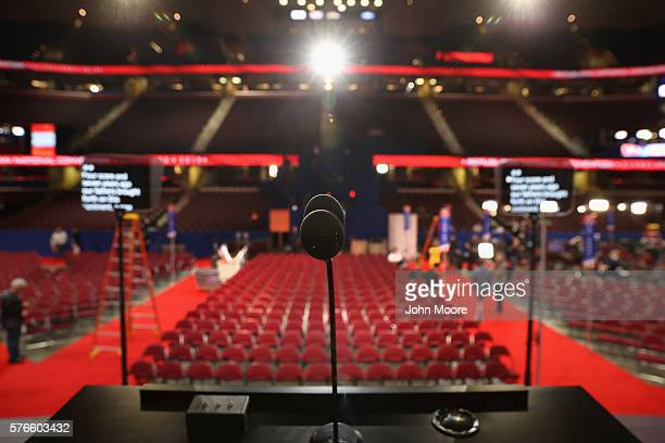A podium microphone and teleprompters stand ready on stage ahead of the Republican National Convention at the Quicken Loans Arena on July 16 2016 in...