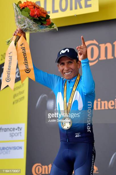 Podium / Nairo Quintana of Colombia and Movistar Team / Medal / Celebration / Miss / Hostess / during the 106th Tour de France 2019, Stage 18 a 208km...