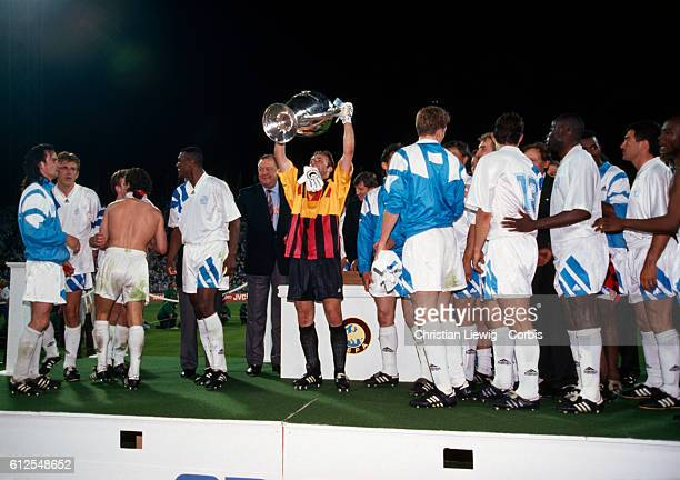 Podium of the Champions Cup Final season 19921993 between Marseille and AC Milan won by Mareille 10 Marseille goalkeeper Fabien Barthez holding the...