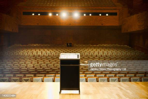 Podium on stage in empty auditorium