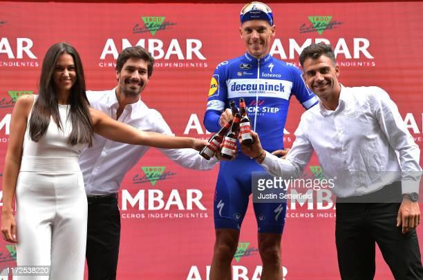 Podium / Philippe Gilbert of Belgium and Team Deceuninck-QuickStep / Óscar Pereiro of Spain Ex Pro-cyclist winner of the Tour of France 2006 /...