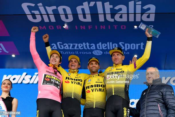 Podium / Primoz Roglic of Slovenia and Team Jumbo Visma Pink Leader Jersey / Sepp Kuss of The United States and Team Jumbo Visma / Paul Martens of...
