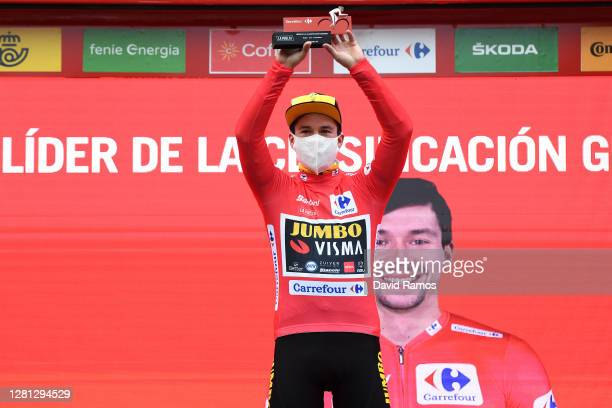 Podium / Primoz Roglic of Slovenia and Team Jumbo - Visma Red Leader Jersey / Celebration / Trophy / Mask / Covid safety measures / during the 75th...