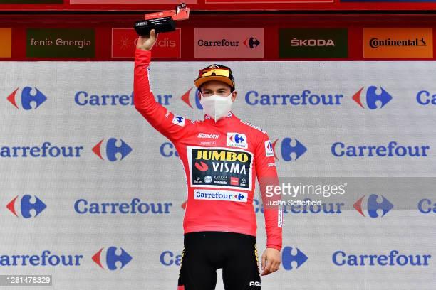 Podium / Primoz Roglic of Slovenia and Team Jumbo - Visma Red Leader Jersey / Oscar Pereiro of Spain Ex Pro-cyclist winner of the Tour of France 2006...