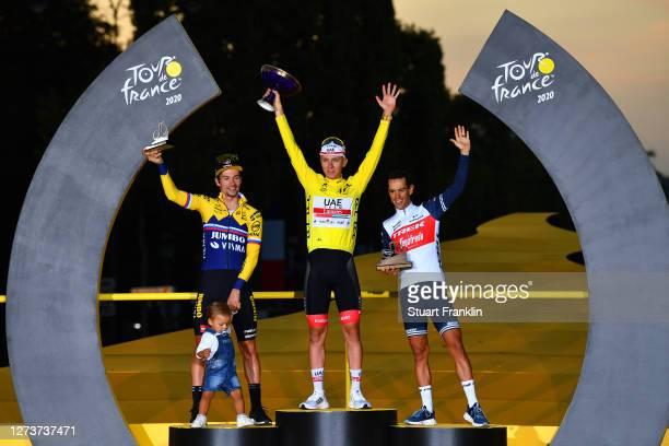 Podium / Primoz Roglic of Slovenia and Team Jumbo - Visma with his son Levom / Tadej Pogacar of Slovenia and UAE Team Emirates Yellow Leader Jersey /...